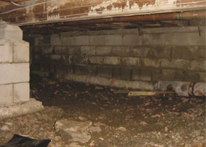 Rotting, decaying crawl space wood damaged over time in Watsonville