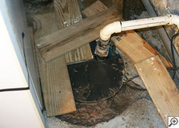 An ugly, clogged sump pump system in Oakland, California