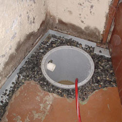 Installing a sump in a sump pump liner in a Modesto home