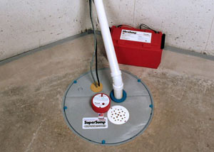 A sump pump system with a battery backup system installed in Hayward